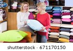 girl and mature woman customers ... | Shutterstock . vector #671170150