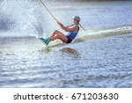 woman surfs on the water  a... | Shutterstock . vector #671203630