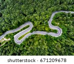winding road trough the forest | Shutterstock . vector #671209678