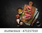 sliced medium rare grilled beef ...   Shutterstock . vector #671217310