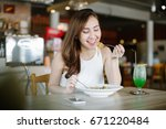 young asia woman eating... | Shutterstock . vector #671220484