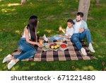 happy multiethnic family eating ... | Shutterstock . vector #671221480