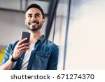 hilarious smiling man keeping... | Shutterstock . vector #671274370