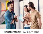 interested coworkers having... | Shutterstock . vector #671274400