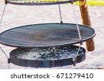 large iron brazier | Shutterstock . vector #671279410