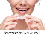 cheerful girl wearing clear... | Shutterstock . vector #671284990