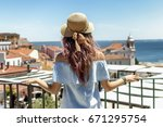 young woman traveling on the... | Shutterstock . vector #671295754