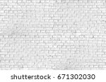 white brick wall background... | Shutterstock . vector #671302030
