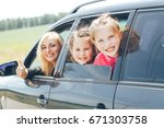 happy kids in car with mom. mom ... | Shutterstock . vector #671303758