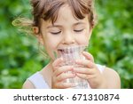 child drinks water. | Shutterstock . vector #671310874