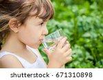 child drinks water. | Shutterstock . vector #671310898