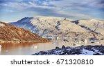 iceberg floating in greenland... | Shutterstock . vector #671320810