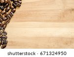 roasted coffee beans on wooden... | Shutterstock . vector #671324950