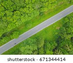 an aerial view of a cow being... | Shutterstock . vector #671344414