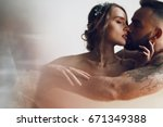 man kisses woman tender while... | Shutterstock . vector #671349388