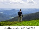 male on green mountain hill... | Shutterstock . vector #671369296