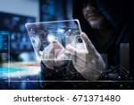 hacker using clear tablet with... | Shutterstock . vector #671371480