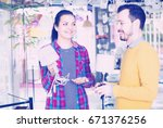 young couple think over  buying ... | Shutterstock . vector #671376256