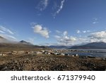 View of the community of Qikiqtarjuaq with a view of a mountain in the background on Broughton Island, Nunavut, Canada