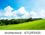 green lawn on small hill with... | Shutterstock . vector #671392420