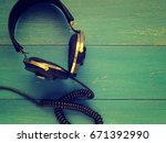 old vintage headphones on a... | Shutterstock . vector #671392990