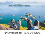 trekking shoes on feet of... | Shutterstock . vector #671394208