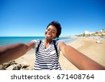 portrait of cheerful young afro ...   Shutterstock . vector #671408764