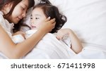 mom and baby.  | Shutterstock . vector #671411998