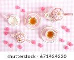 small tea set in pink.... | Shutterstock . vector #671424220