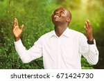Small photo of Smile african man praying for thank god.