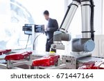 automated robotic arm polishing ... | Shutterstock . vector #671447164