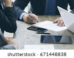 business man sign contract on... | Shutterstock . vector #671448838