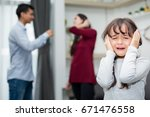 Small photo of Frustrated of little girl is disaster in argument of mother and father in family conflict,Family Concept