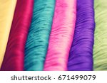 stack of colorful clothes | Shutterstock . vector #671499079