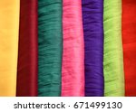 stack of colorful clothes | Shutterstock . vector #671499130