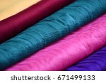 stack of colorful clothes | Shutterstock . vector #671499133