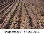 black soil plowed field. earth... | Shutterstock . vector #671518018