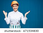 smiling woman wearing building... | Shutterstock . vector #671534830