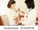 doctor looking at a baby while... | Shutterstock . vector #671543740