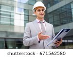 businessman holding folder with ... | Shutterstock . vector #671562580