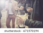 group of friends drinking wine  ... | Shutterstock . vector #671570194
