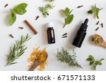two bottles of essential oil... | Shutterstock . vector #671571133