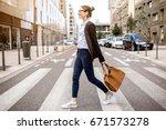 young businesswoman crossing... | Shutterstock . vector #671573278