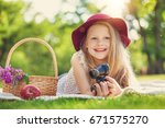 little girl playing and eating... | Shutterstock . vector #671575270