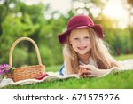little girl playing and eating... | Shutterstock . vector #671575276