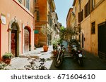narrow street in rome  italy at ... | Shutterstock . vector #671604610