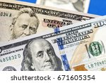 american dollars. a stack of... | Shutterstock . vector #671605354