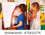 children painting finger on... | Shutterstock . vector #671611174