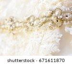 wedding dress detail  | Shutterstock . vector #671611870