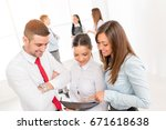 three young colleagues... | Shutterstock . vector #671618638
